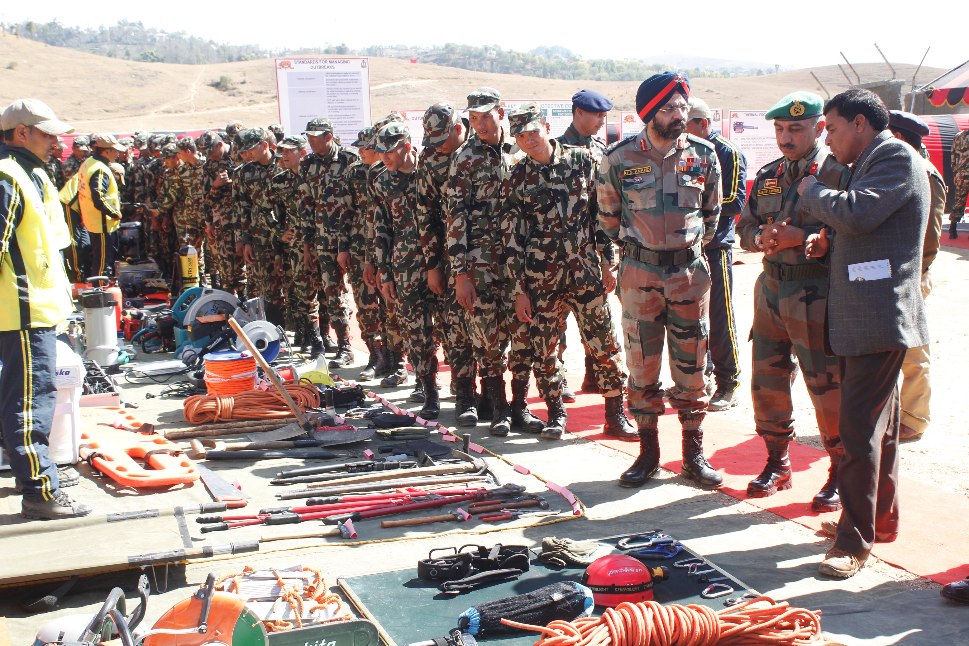 INDO NEPAL TROOPS BEING BRIEFD BY SDRF DURING EQPT DISPLAY OF DISASTER MGMT TOOLS (2).JPG