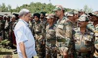 The Union Minister for Defence, Shri Manohar Parrikar interacting with the troops in forward area visit, in Rajouri sector on May 23, 2015.