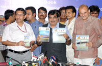 The Union Minister for Road Transport & Highways and Shipping, Shri Nitin Gadkari releasing the e-Book of his Ministries, on the completion of one year of the NDA Government, in New Delhi on May 28, 2015. The Secretary, Ministry of Road Transport and Highways, Shri Vijay Chibber and the Secretary, Ministry of Shipping, Shri Rajive Kumar are also seen.