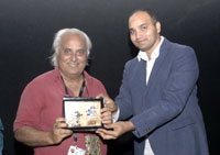 Producer and Director Jay Bajaj being felicitated at the 46th International Film Festival of India (IFFI-2015), in Panaji, Goa on November 28, 2015.