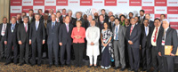 The Prime Minister, Shri Narendra Modi and the German Chancellor, Dr. Angela Merkel in a family photo, at the Indo-German Summit 2015, organised by the NASSCOM & Frauenhofer Institute, in Bengaluru on October 06, 2015.