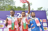 Pankaj Kumar of India wins the Bronze Medal, PJMJ Silva of Sri Lanka wins the Gold and MANR Appuhamy wins the silver Medal, in the 60 Km Criterium Race of Man in the cycle events of the 12th South Asian Games-2016, in Guwahati on February 07, 2016.