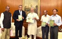 The Prime Minister, Shri Narendra Modi releasing a book 'The Birds of Banni Grassland', presented by the Scientists of Gujarat Institute of Desert Ecology, in New Delhi on June 28, 2016. The Additional Principal Secretary to the Prime Minister, Dr. P.K. Mishra is also seen.