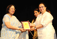 The Union Minister for Minority Affairs, Dr. Najma A. Heptulla presenting the Badalte Qadam Award to the First Indian Bike Rider, Ms. Shabnam Akram, at the Best Achievers Award Ceremony, organised by the Child Care & Welfare Foundation, in New Delhi on May 06, 2016.