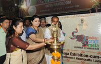 The Union Minister for Textiles, Smt. Smriti Irani lighting the lamp at the Indian Craft Mela Mega Exhibition-cum-Sale, in New Delhi on October 22, 2016.  The Minister of State for Textiles, Shri Ajay Tamta and the Member of Parliament, Smt. Meenakshi Lekhi are also seen.