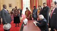 The Vice President, Shri M. Hamid Ansari signing the Visitor's Book at the State House, in Entebbe, Uganda on February 22, 2017.