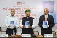 Dr. D. Bhalla, IAS, releasing the book World Economic Crises and India, in the presence of the Minister of State for Finance and Corporate Affairs, Shri Arjun Ram Meghwal, in New Delhi on March 30, 2017.