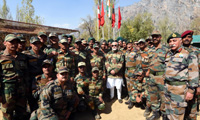 The Prime Minister, Shri Narendra Modi celebrating Diwali with the jawans of Indian Army and BSF, in the Gurez Valley, near the Line of Control, in Jammu and Kashmir, on October 19, 2017. The Chief of Army Staff, General Bipin Rawat is also seen.